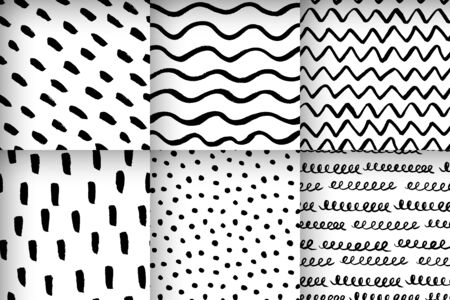 Set of abstract ink brush pen drawing seamless patterns. Vector art. Black scribble and white background. Vettoriali