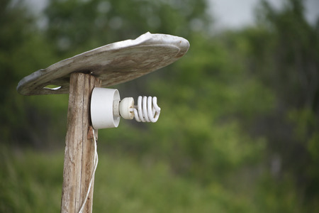 resourcefulness: homemade lantern in the village with energy-saving lamp