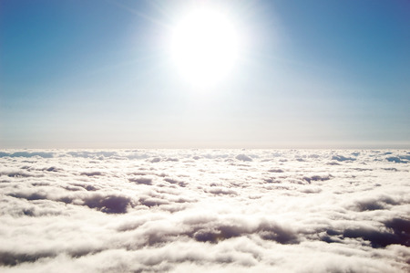 white space: horizon above the clouds , the sun sky and clouds