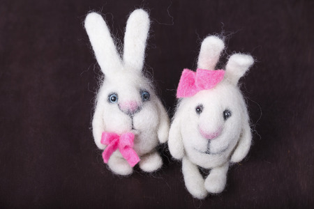 a pair of white decorative bunnies with pink bows photo