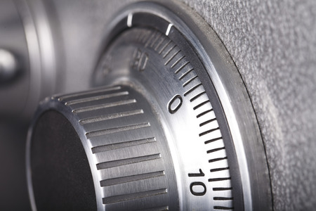 combination lock on the safe closeup gray Stock Photo