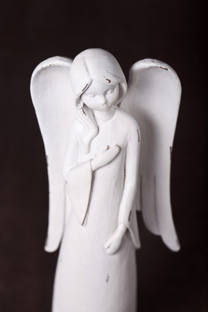 sanctity: a statuette of an angel in white