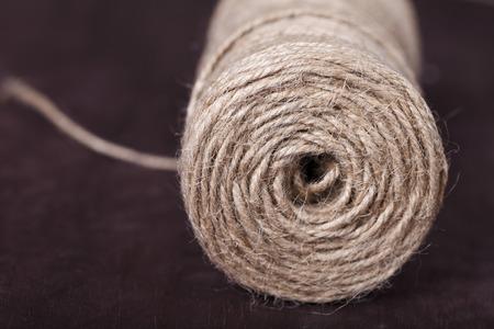 skein: skein of twine on a brown background close-up