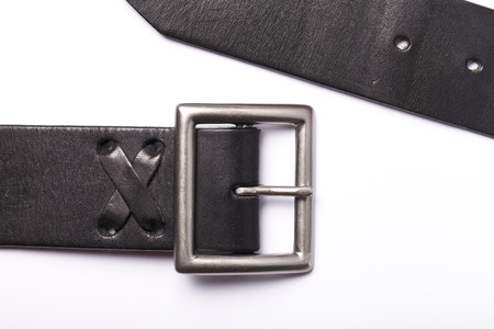 fastener: Black belt with a fastener isolated on a white background Stock Photo