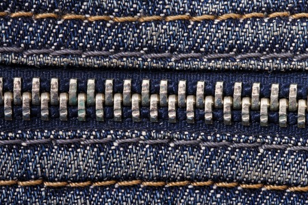 tight focus: Jeans zipper close up blue seams