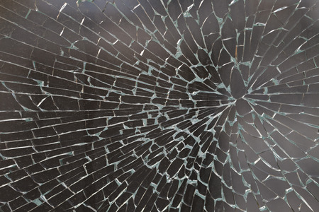 vandal: cracked glass closeup background texture