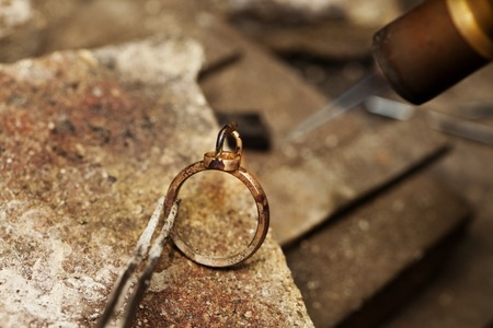 silver jewelry: jeweler solder ring close-up background