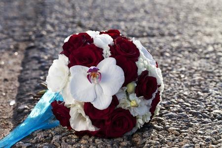 floristics: WEDDING BOUQUET of the ROSE of the ORCHID floristics