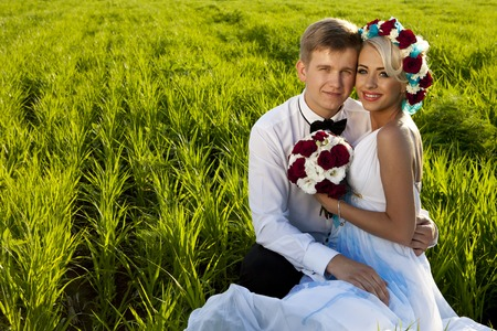 girl friend: a Happy bride and groom on the bright green field