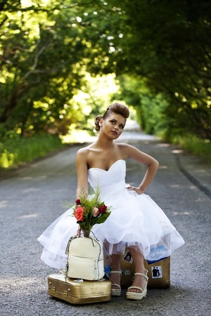 beautiful redhead: a Beautiful redhead bride with suitcases