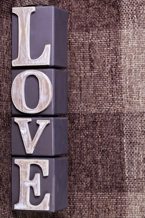 goodness: a word love from cubes on a brown background Stock Photo