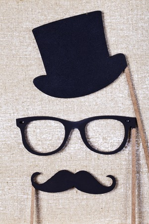 red abstract background: a wedding props mustache and glasses