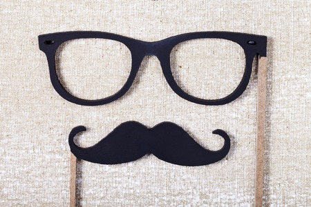 photo of accessories: a wedding props mustache and glasses