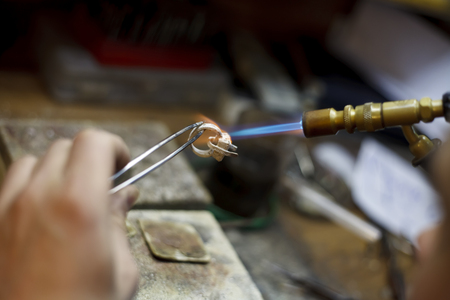in jewelry: a ewelry making close-up details of the production