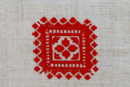 lappet: a red crosses embroidered pattern in national style