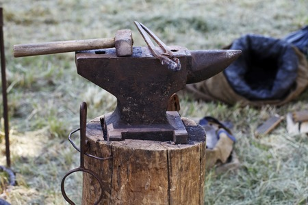 medieval blacksmith: a anvil and other blacksmith tools close-up Stock Photo