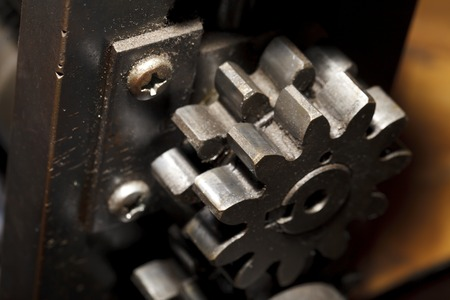 worm gear: a Iron machine detail close-up , industrial background