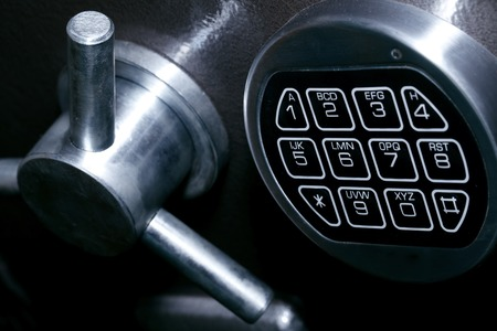 turn dial: safe close-up, banking and finance Stock Photo