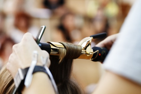 stylist hairdresser doing haircut closeup of work equipment, the beauty industry Archivio Fotografico