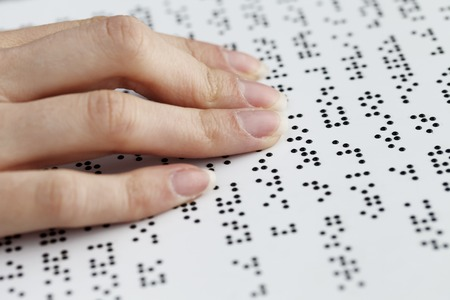 a blind reading, fingers and symbols closeup