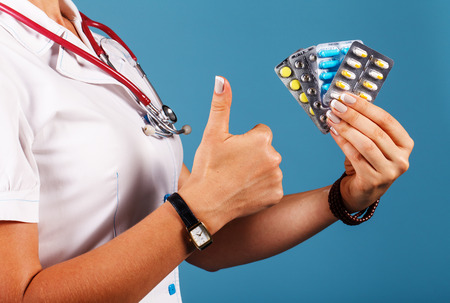 Doctor with pills in hand closeup Stock Photo