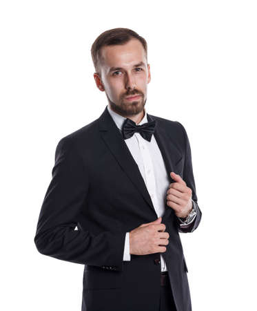 Half-length portrait of representative young businessman in black suit and bow tie isolated on white background