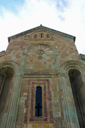 stone carvings: cathedral wall with a window and stone carvings