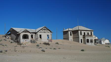 kolmanskop: Kolmanskop ghost town sinking in sand sea, Namibia