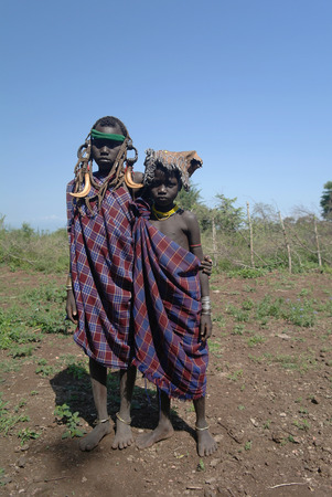 Portrait of Mursi tribe girls, Omo valley, Ethiopia Editorial