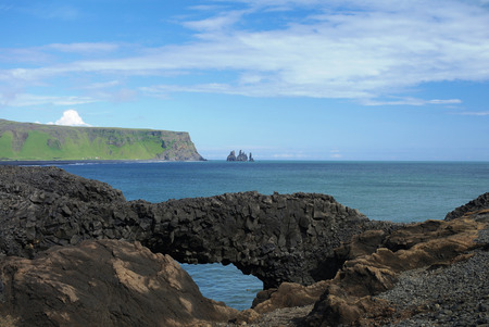 stone arch: Dyrholaey cape, natural stone arch, South Iceland Stock Photo