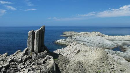 kuril: Rocks of Stolbchatiy cape in Kunashir, kuril islands, Russia Stock Photo