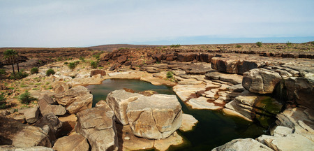 atar: Panorama of rocky pond on Adrar plateau, Mauritania