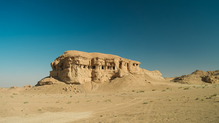 Butte at the dried shore of Razazza lake aka Milh lake or Sea of Salt, Iraq