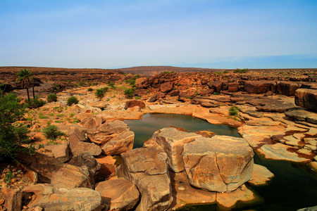 Panorama of rocky pond on Adrar plateau, Mauritania