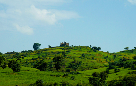 Agriculture landscape with Guzara castle and fields of teff , Ethiopia