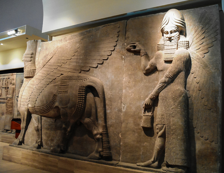 Bas of human-headed winged bull statues aka lamassu in Baghdad, Iraq