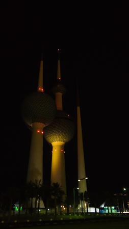 famous industries: Exterior view to fresh water reservoir aka Kuwait Towers at night in Kuwait Stock Photo