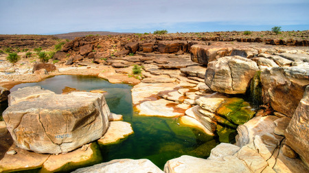 atar: Panorama of rocky pond on Adrar plateau in Mauritania