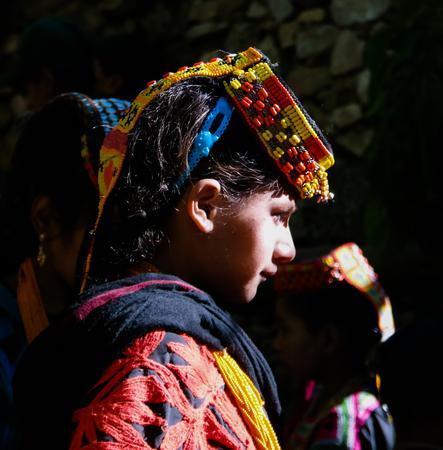 feast: Portrait of Kalash tribe woman in national costume at Joshi fest - 14-05-2015 Bumburet, Kunar, Pakistan Editorial