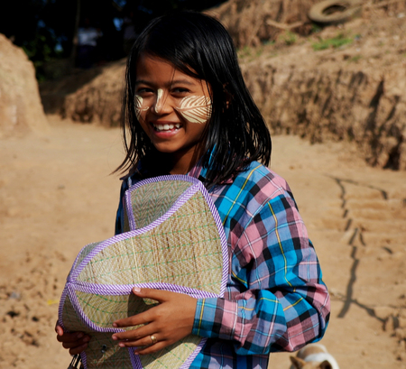 Portrait of Myanmar girl with thanaka - 03-01-2013 Mandalay, Myanmar