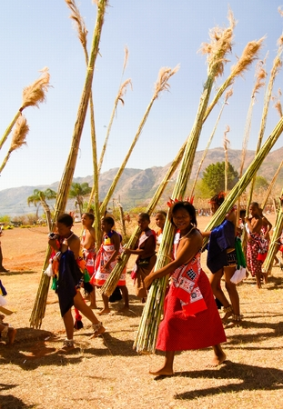 Women in traditional costumes marching at the Umhlanga aka Reed Dance ceremony - 01-09-2013 Lobamba, Swaziland