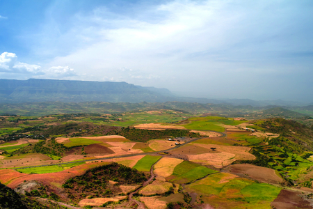 Aerial Panorama of Semien mountains and valley with fields of teff around Lalibela,Ethiopia