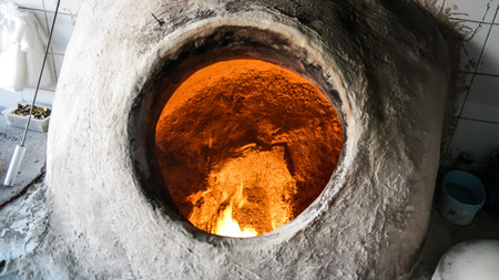 Baking the bread in tandoor at Manama, Bahrain