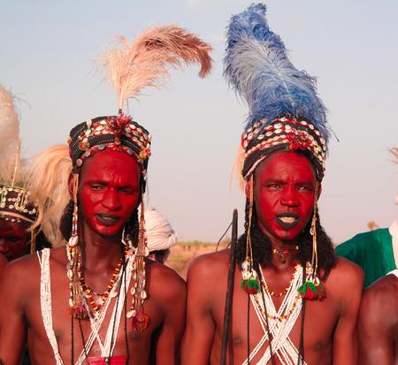 Man dancing Yaake dance and sing at Guerewol festival - 23 september 2017 InGall village, Agadez, Niger