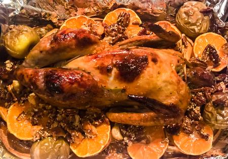 oven baked Guinea fowl aka Italian Christmas dish with pumpkin Mandarin, macadamia, pecan, honey, sesame seeds, rosemary, pepper, salt. Moscow, Russia Stock Photo