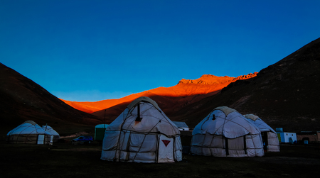 Sunrise over kyrgyz Yurts at Tash-Rabat river and valley at Naryn province, Kyrgyzstan