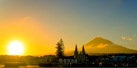 Sunrise over Madalena and Pico volcano and island at Azores, Portugal Stock Photo
