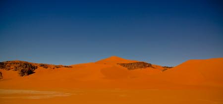 Landscape of sand dune and sandstone nature sculpture at Tamezguida in Tassili nAjjer national park in Algeria