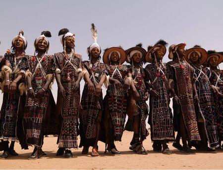 Men dancing Yaake dance and sing at Guerewol festival - 23 september 2017 InGall village, Agadez, Niger