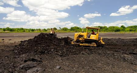 Asphalt mining in the Pitch Lake at La Brea in Trinidad and Tobago